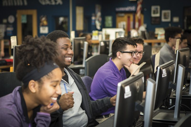 Smiling Tulsa Public Schools students in a computer lab.