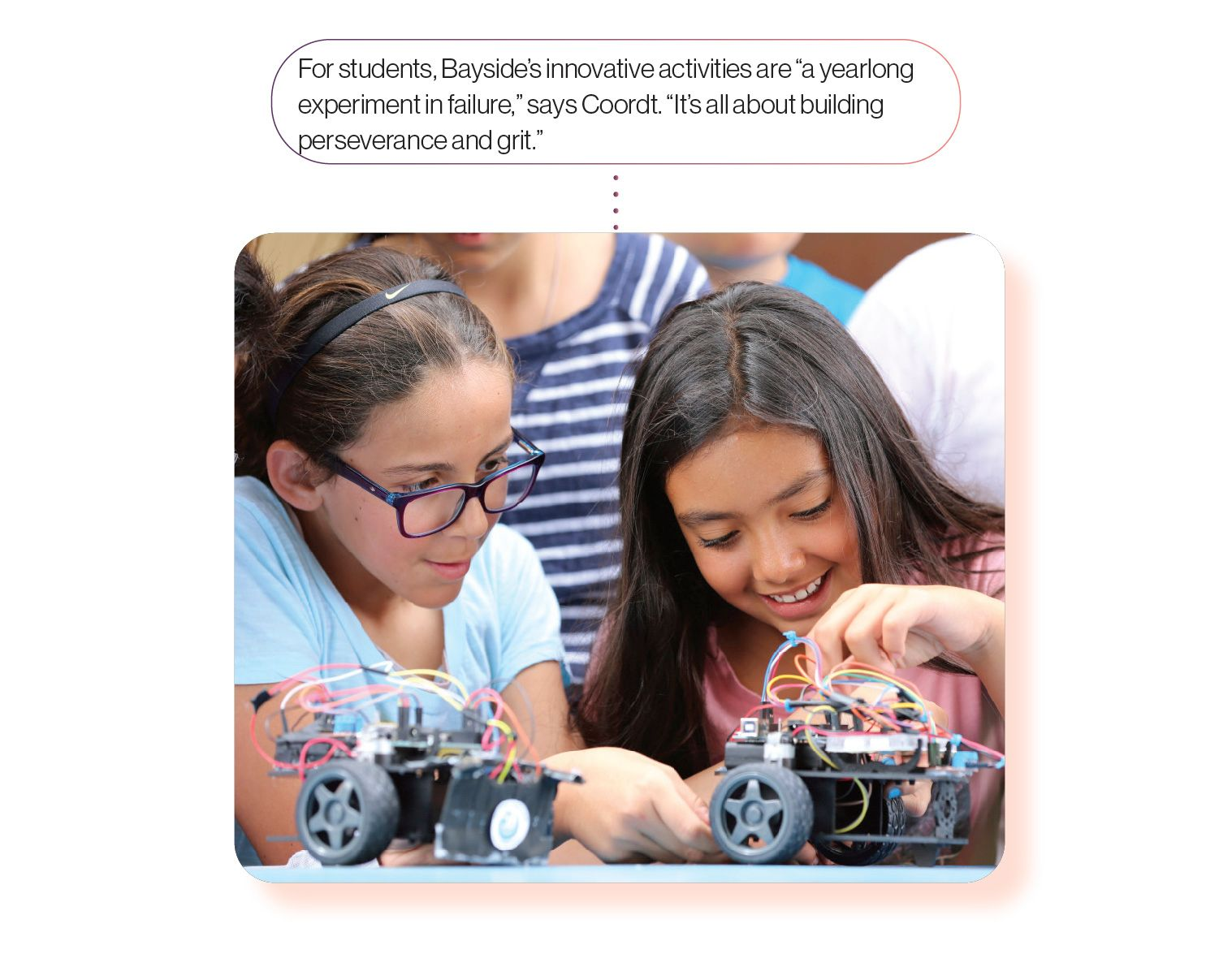 Image: Two young students learning with robots, with the caption 'Kids at Bayside STEAM Academy use 'exploration time' to learn about everything from robotics to birdwatching.'
