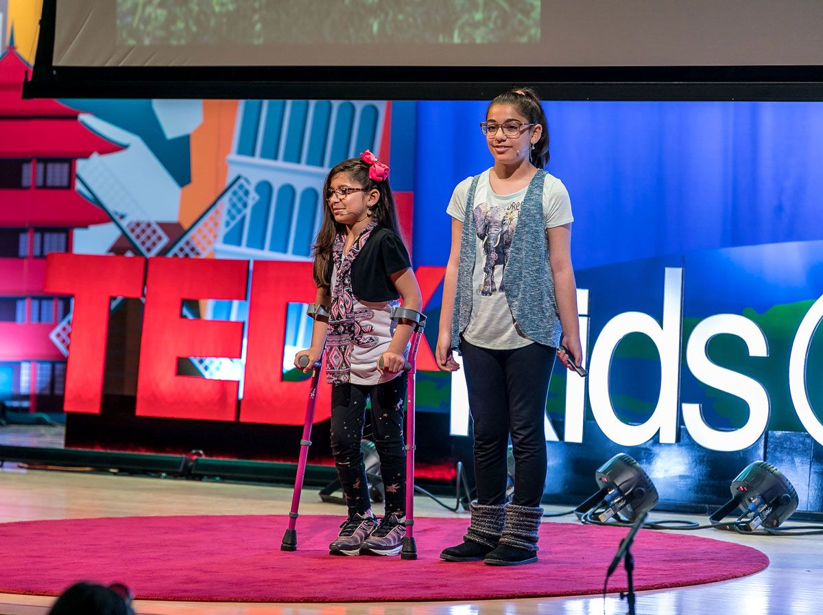 Two students giving a talk as part of TEDxKids