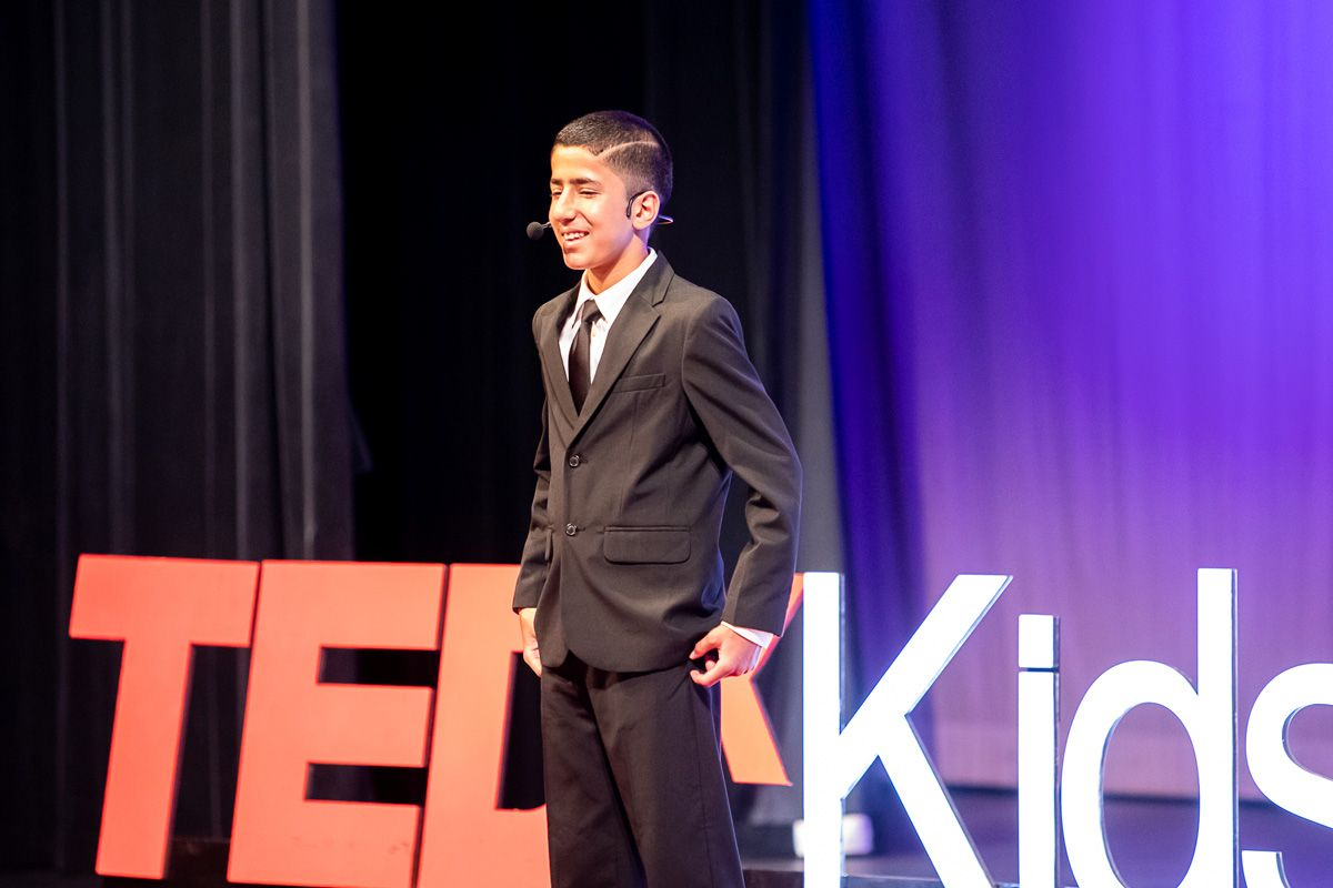 A young student from Cajon Valley giving a speech on stage